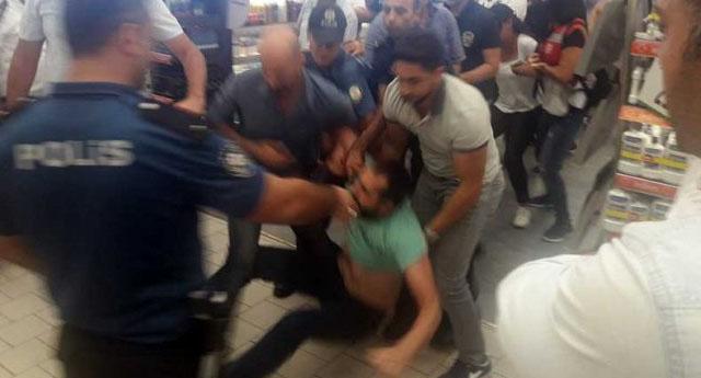 Haklarını arayan Migros çalışanlarına polis müdahalesi ile karşılaştı