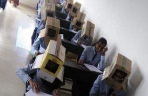 Kafalarına kutu geçirmiş öğrenciler sınıfta ne yapıyorlar?