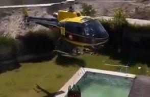 Çılgın helikopter pilotu, yüzme havuzundan su alıyor