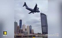 Kargo uçağı gökdelenlerin arasına inince halk panikledi